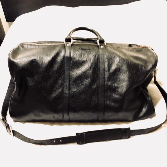 45fb46b8048 Gucci Handbags - Gucci black leather duffel bag GG Guccisma print